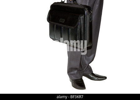 the man costs and holds in a hand an brief case - Stock Photo