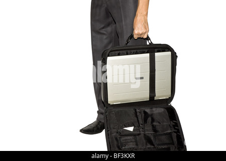 the man costs and holds in a hand an open bag with the laptop - Stock Photo