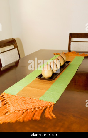 Artificial pears on a dining table - Stock Photo