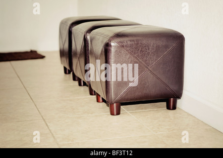 Three ottomans in a living room - Stock Photo