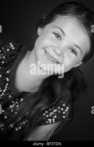 Black and White Portrait of a Pretty Brown Haired Child - Stock Photo