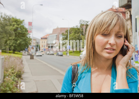 Woman in the street making a phone call - Stock Photo