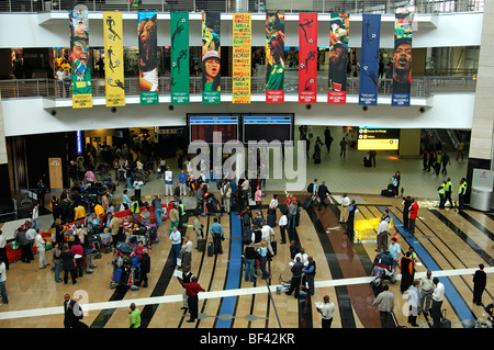 Travellers in the arrival hall of the O.R. Tambo International Airport (ORTIA), Johannesburg, South Africa