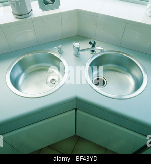 Close-up of circular double stainless-steel sinks in modern kitchen - Stock Photo
