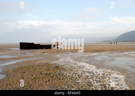 Abandoned boat on the beach at Red Wharf Bay, Anglesey, North Wales - Stock Photo