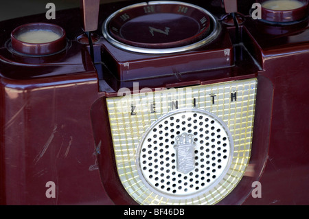 Zenith antique vintage purple radio with scratches and wear marks showing years of use. - Stock Photo