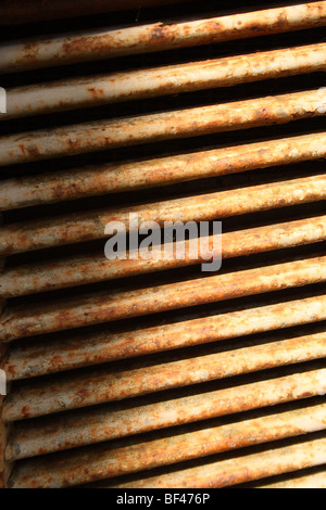 Rusty steel engine grill / air vent on front of old Massey Ferguson tractor at Scorton, Lancashire, United Kingdom. - Stock Photo
