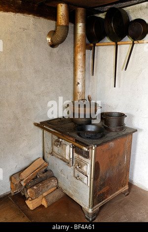 Old stove with an oven pipe, kitchen, historic bakery from 1730, Wolfegg Farmhouse Museum, Allgaeu, Upper Swabia, - Stock Photo