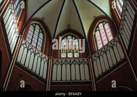 Stained glass windows in the east apse, with remaining medieval stained glass windows, Doberaner Muenster cathedral - Stock Photo