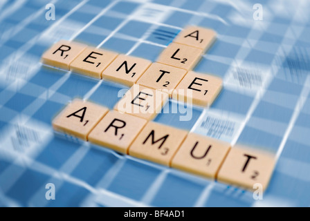 The words 'Alter', 'Rente ' and 'Armut ', German for 'age', 'pension' and 'poverty', composed of tiles, symbolic - Stock Photo