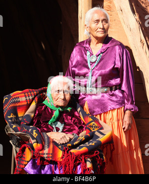 Two Navajo Wise Elderly Women Outdoors in Bright Sun - Stock Photo