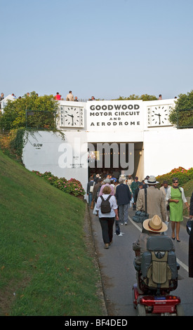 Goodwood Revival crowd passing through a tunnel under the motor racing circuit. west Sussex UK 2009 - Stock Photo