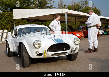1962 AC Cobra, RAC TT race entrant, in the paddock with marshalls at the 2009 Goodwood Revival, Sussex, UK. - Stock Photo