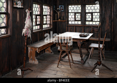 Historic living room of a farm house from 1856, spinning wheel, Wohnspeicher type of farm house from Lauben, Wolfegg - Stock Photo