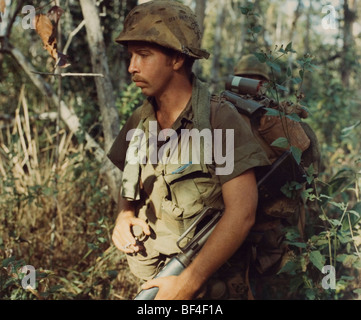 A member of the 1st Cavalry division walks on patrol during 1968 in the Vietnam War. - Stock Photo
