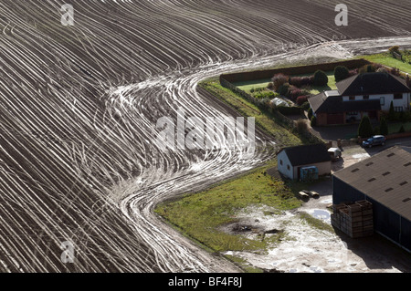 An aerial view of tractor tracks in the soil. - Stock Photo