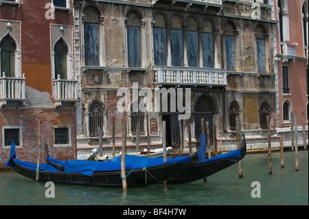 Gondola on Canale Grande in front of palace, Venice, Veneto, Italy, Europe - Stock Photo