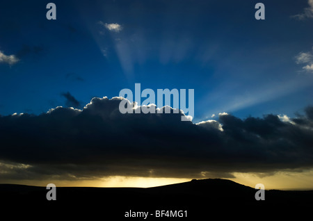 Silver lining to dark cloud with sun rays above, Devon UK - Stock Photo