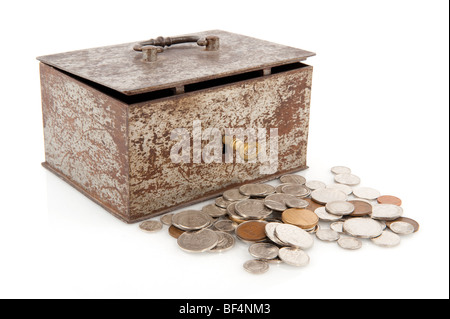 Old rusty money box with golden key and coins - Stock Photo