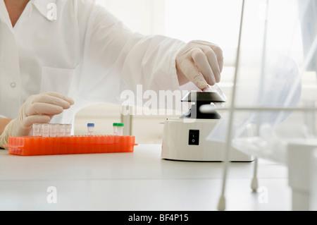 Chemist in a laboratory - Stock Photo