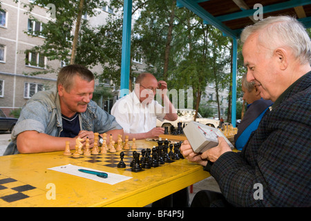 Senior men playing chess in park,  Ekaterinberg, Russia - Stock Photo