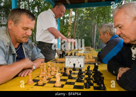 Russian men playing chess in park,  Ekaterinburg Russia - Stock Photo