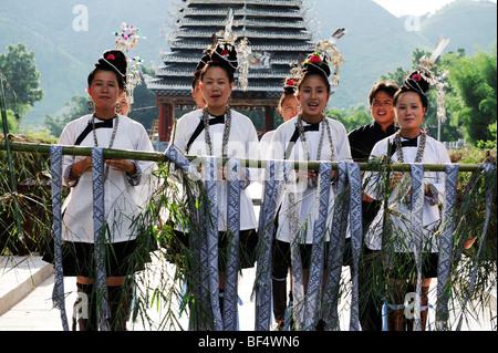 Dong young women wearing Dong traditional costume singing, Chejiang Dong village, Rongjiang County, Guizhou Province, - Stock Photo