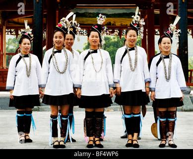 Dong young women wearing Dong traditional costume singing, Chejiang Dong village, China - Stock Photo