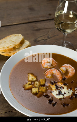 Fish soup, Soupe de Poisson, with shrimp, croutons and Dulse (Palmaria palmata), a red alga - Stock Photo