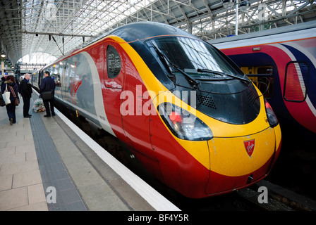 Intercity express tilt train operated by Virgin Trains: a Pendolino train at a station. Please click for details. - Stock Photo