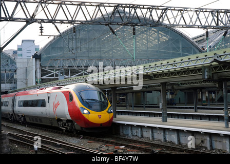 Intercity express train at a station. Virgin Trains Pendolino Express train at Manchester Piccadilly Station. Fast - Stock Photo
