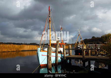 Fishing boats in the little harbour of Gothmund at the Trave river, hanseatic city of Luebeck, Schleswig-Holstein, - Stock Photo