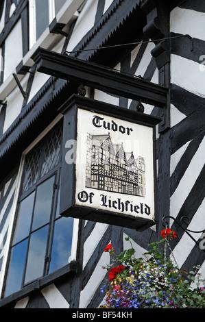 Old pub sign, Tudor of Lichfield, on a half-timbered Tudor-style house, Bore Street, Lichfield, Staffordshire, England, - Stock Photo