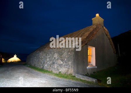 The Garenin Trust traditional Scottish Blackhouse at night on the Isle of Harris Western Isles Outer Hebrides Scotland - Stock Photo