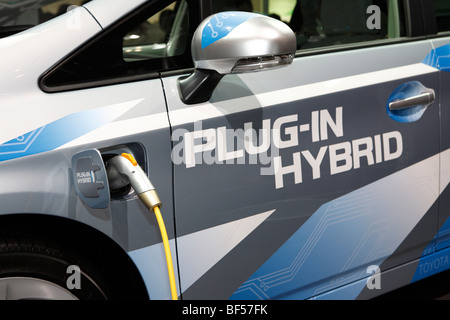 A plug-in hybrid electric vehicle (PHEV) - Stock Photo