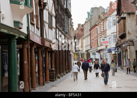 people walking on Winchester High Street in England - Stock Photo