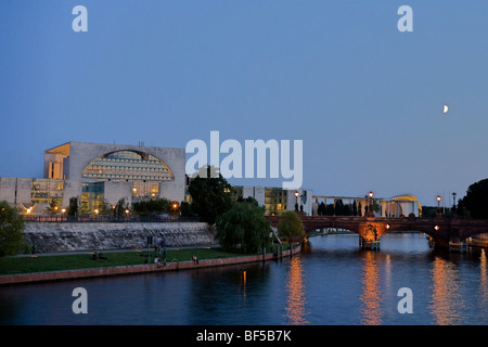Federal Chancellery with Moltke Bridge as seen a bank of the Spree River on a summer evening, Mitte, Berlin, Germany, - Stock Photo