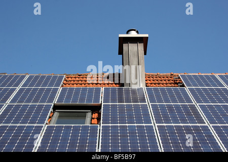 Photovoltaic system on a rooftop - Stock Photo