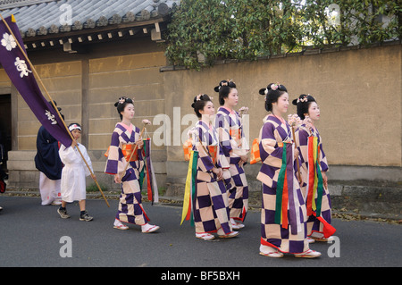 Women wearing kimonos, procession through a residential area, Kyoto, Japan, Asia - Stock Photo