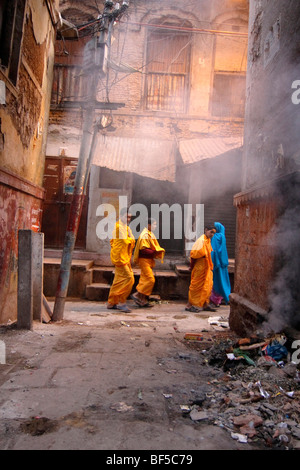 Young monks in bright robes, Varanasi, India, South Asia - Stock Photo