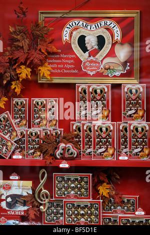 Candy shop, display window, genuine Reber Mozartkugeln pralines, Alter Markt square, Salzburg, Austria, Europe - Stock Photo
