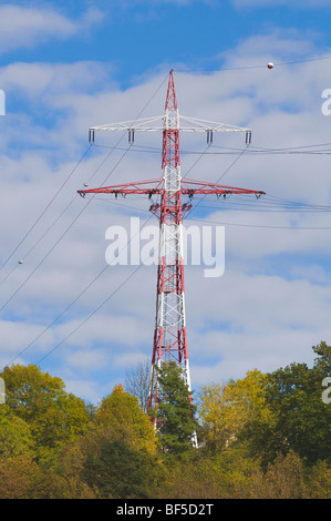 Electricity pylon marked with red and white balls in an aircraft flight path, Germany, Europe - Stock Photo