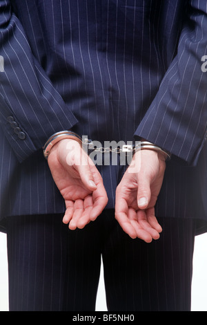 Businessman in handcuffs - Stock Photo
