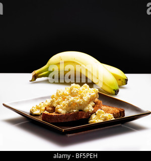low calorie healthy choice of banana and eggs on toast - Stock Photo