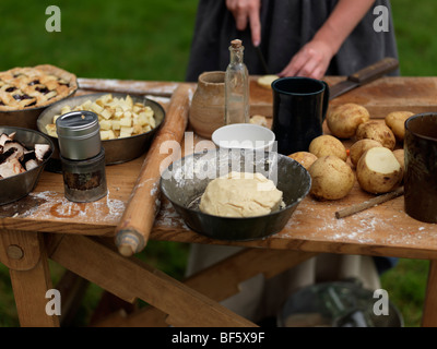 Canada, Ontario, Fort Erie, Old Fort Erie, War of 1812 reenactors in period costume preparing an old fashion meal - Stock Photo