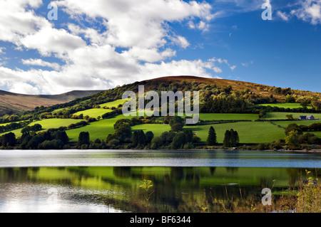 Perfect reflection at Talybont reservoir, Brecon Beacons in Wales taken on beautiful bright sunny day - Stock Photo