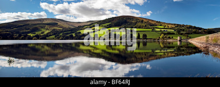 Panoramic perfect reflection at Talybont reservoir, Brecon Beacons in Wales taken on beautiful bright sunny day - Stock Photo