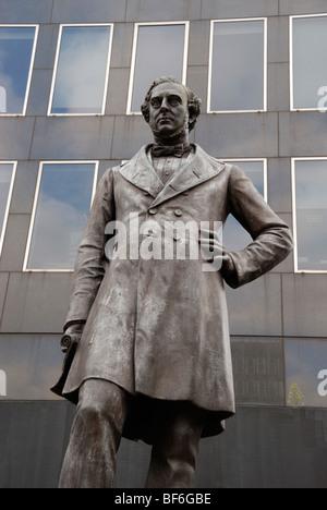 Statue of the civil engineer Robert Stephenson outside Euston Station, London, England, UK - Stock Photo