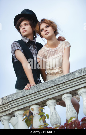 Young elegant couple standing at the railing. - Stock Photo