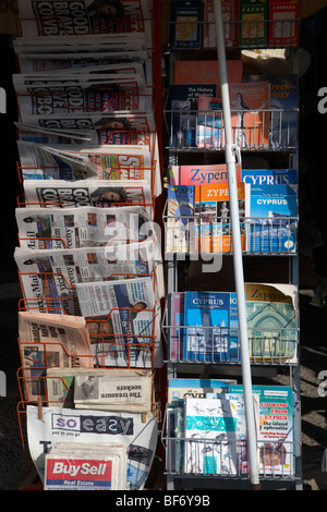 english british newspapers and cyprus guidebooks for sale in a cypriot newsagents larnaca republic of cyprus - Stock Photo